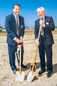 Thomas Wermers (current CEO of Wermers Companies) breaks ground alongside his father and company founder, James J. Wermers. Photo taken in 1997 at the groundbreaking of Sycamore Apartments in Northern California.